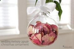 Save some petals from your wedding bouquet and place them in a clear Christmas ornament. Hang it on your tree every year and remember what an amazing time you both had. This is a beautiful way to commemorate your union, and you'll love knowing that you'll always have a little piece of that day to keep with you forever.