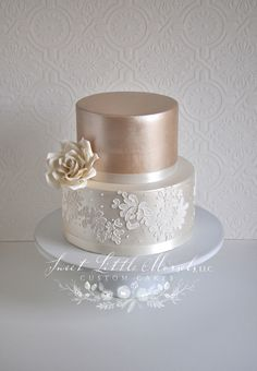 Simple Two Tone Champagne Wedding Cake Simple wedding cake.Sweet and simple two toned luster wedding cake with lace applique on the bottom tier. Accented with a sugar rose.Wedding cakes can go from the simplest to the most intricate designs; 8 Tier Wedding Cakes, Champagne Wedding Cakes, Small Wedding Cakes, Elegant Wedding Cakes, Beautiful Wedding Cakes, Wedding Cake Designs, Wedding Cupcakes, Wedding Vintage, Rustic Wedding