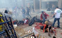 Boston Bombing: I look a the guy in the middle far left... the one holding the American flag............ no words