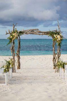Beautiful driftwood arch for a beach wedding