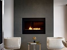 Concrete fireplace surround with a Spark fireplace. Concrete Fireplace Surrounds -Trueform Concrete Custom Work