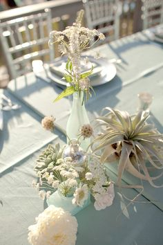 Aqua seaside wedding centerpieces.   Nautical and beach themed Maine weddings catered by Foster's Premium Catering, York, Maine. http://www.fosterspremium.com. Fosters Clambakes and Catering authentic New England lobster and clambakes. http://www.fostersclambake.com