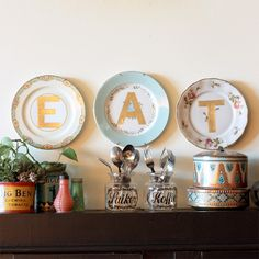 Turn thrift store plates into charming gold monogramed home decor for your kitchen or personalized gifts.