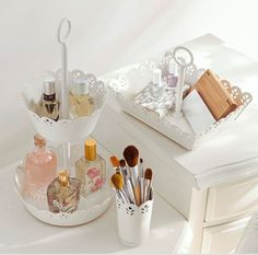 Dressing table organisation- makeup, brushes, perfume, jewelry. Baskets and trays.