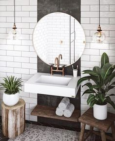 Bathroom sink, industrial lighting, large mirror, wooden textures and indoor plants #bathroom #bathroomideas #bathroomdesign #interiordesign #bathroomstyling #bathroomdecorating