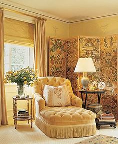 ** Seating area with a golden glow and decorative screen