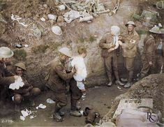 Medical orderlies tend to the wounded in a trench during the Battle of Courcelette (part of the Somme Offensive) in mid-September 1916. The soldiers are supposedly Canadians. This photo shows one particularly famous unknown soldier whose cropped photo has been posted and printed many times: I'm talking about the man crouching and smiling at the camera. The most sympathetic descriptions of this man's mental state simply point out that he is a victim of shell shock.
