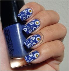 I applied two coats of Catrice - Pool Party At Night and stamped with Konad Special Polish in White and a pattern from Bundle Monster plate BM-224. I also added a couple of yellow rhinestones and a layer of top coat.
