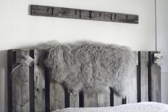 "gorgeous headboard & sheepskin rug by  ""my old blue suitcase"" furrugs.com"