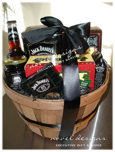 Love this idea ...but maybe with Baily's,  coffee, mugs, dunkers and a coffee table book. Showing Basket is Whiskey Barrel Gift Basket - Contains Jack Daniels including nuts, jam, cake, coffee & more!