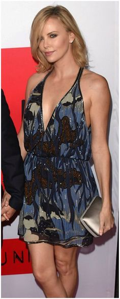 Steal Charlize's style in an elegant Gucci mini dress