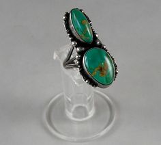 Territorial Indian Arts  Two lovely deep green turquoise  stones from the Royston Mine are set in a sterling silver ring hand crafted by a Navajo Indian artist.