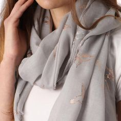 Ladies' Light Grey bird and butterfly foil print scarf, by Style Slice, features shiny metallic hummingbirds and butterflies printed in gold. Elegant spring or summer shawl that can be personalised with a charm or a monogram. Suitable as a gift for anniversary, birthday or any day in which to tell the woman in your life, be it a Mum, Wife, Sister or Girlfriend, that she is special. #scarf #shawl #wrap #scarves #fashion #vintage #handmade #accessories #etsy #gift #headwrap #ootd #pashmina…