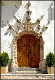 16c. Manueline (Portuguese gothic) door of Olivenza town hall, Extremadura. Situated on a disputed section of the border between Portugal and Spain, Olivenza is claimed by both and is currently administered by Spain // photo by Virco PT