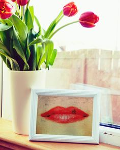 Romantic and quirky surreal photographic print of red lips with an extra touch of a sweetness provided by a walking couple.  TITLE: Walking on the