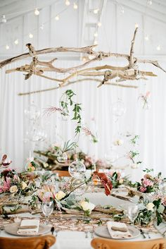 Chandelier of glass spheres holding candles hanging from gorgeous driftwood pieces. Source: stylemepretty.com #chandelier #driftwood #weddinglighting