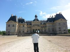 Le Chateau de Vaux Le Vicomte, view of the front with a husband taking his own picture of it.