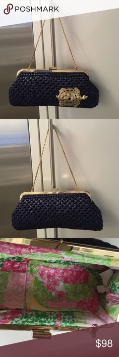 """NWOT Lilly Pulitzer navy straw bag cotton lining NWOT Lilly Pulitzer navy straw bag cotton lining.  Has gold decorative tortoise on bag with """"xx Lilly"""" on bar to the left of clasp.   Very versatile can be worn as a clutch of handbag.  Clutch measures approx 11"""" x 5"""".   Chain has 8"""" drop.   Super cute true navy color.  Cotton straw has a nice shine to it -- gives it something special. Lilly Pulitzer Bags"""
