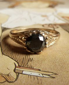 Into the black and grey diamonds. Art Nouveau Style Black Diamond Ring by Kate Szabone on Etsy