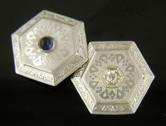 Beautifully engraved platinum-top cufflinks set with blue cabochon sapphires and sparkling white diamonds.  The hexagonal borders are decorated with intricate geometric designs in the Art Deco fashion.  An elegant accent to any cuff.  Crafted in platinum and 14kt gold,  circa 1920.