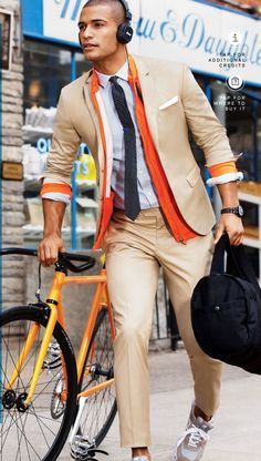 Men's White Pocket Square, Khaki Dress Pants, Grey Athletic Shoes, White and Blue Vertical Striped Dress Shirt, Black Watch, Orange Bomber Jacket, Tan Blazer, Black and White Polka Dot Tie, and Black Canvas Holdall
