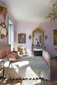 fairytale château ~ 19th-century French bed,  18th-century Delft vases, early 19th-century bronze clock shaped like Cupid. The palm tree chandelier is circa 1914.
