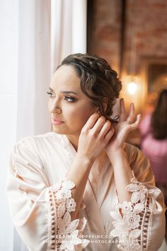 How beautiful is this bridal look?! She had a bun updo with a braid in the front and a few loose strands of hair to shape her face. Plus, we love to see our brides wearing our soft, satin and lace bridal robes the morning of the wedding! Shop all Wedding Shoppe bride & bridesmaid robes online or in store today! | wedding accessories | bridal robes | bridal hairstyles | satin and lace wedding robes | beautiful wedding look | wedding dresses and accessories from Wedding Shoppe Blush Pink Bridesmaid Dresses, Blush Pink Wedding Dress, Blush Pink Weddings, Bridesmaid Robes, Wedding Dresses, Lace Bride, Bridal Lace, Lace Wedding, Bun Updo