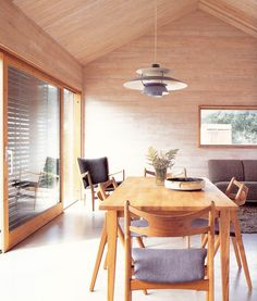peter hulting cabin in southwestern sweden - hans wegner chairs and ph5 lamp by henningsen from the book scandinavian country