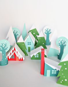 Christmas Village printable holiday houses, christmas trees, and woods DIY paper craft project to decorate your house for the Holidays.