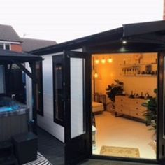 Transform your garden with a gazebo hot tub shelter and log cabin summerhouse.