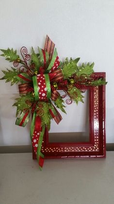 Alternative Christmas wreath made from a repurposed picture frame.