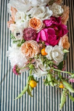 White, peach and pink centerpiece with ticking stripe runner