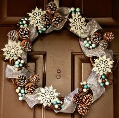 To make this next wreath, I wrapped a silvery, glittery ribbon loosely around the wreath. Then I added the super cheap pine cones, berries, and glittery snowflakes.