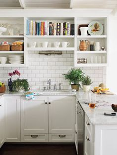 perfect cottage kitchen with marble counters, subway tile, white shaker style cabinets, and open shelving