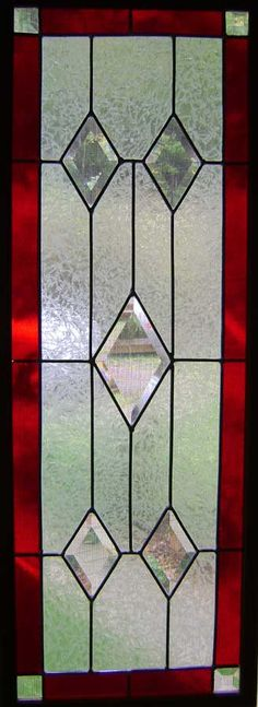 a leaded red window with bevels