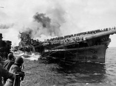 Aircraft carrier USS Franklin (CV-13) afire and listing after she was hit by a Japanese air attack while operating off the coast of Japan. Many of the crewmen were blown overboard, driven off by fire, killed or wounded, but the hundreds of officers and enlisted who voluntarily remained saved their ship through sheer tenacity. The casualties totaled 724 killed and 265 wounded, and would have far exceeded this number if it were not for the exemplary work of many survivors. March 19, 1945