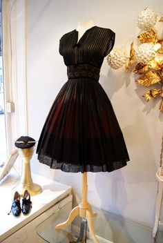 Vintage lovely- especially with a fluffy red crinoline underneath....