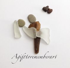 """ bride and groom"" #agifttorememberart #pebbleart #art #artwork #handmade #giftideas #etsy #etsyseller #australia #beachdecor #mumswhomake #inlove #wedding #makersgonnamake #love #roomdecor #seaglass #stone #instaart #instaphoto #bride #brideandgroom"