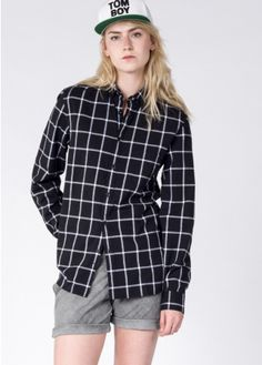 This inky black button up has a contrast windowpane print which adds an edge of modern to a classic silhouette.