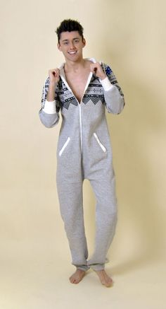 A popular item this year, this mens onesie looks amazing on and it's so comfy that you won't want to take it off. It features an aztec print to the shoulders (front and back), soft fleece linings, full length sleeves, front zip fastening, two front pockets, aztec print pocket to the back and a lined hood with drawstring. Wear indoors or out! Everyone wants a onesie this year so get yours now, before they sell out!