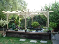 Pergola over the pond to deter herons and add a bit of for Koi pool thornton