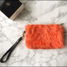 "KC Furry wristlet Faux fur wrislet in orange . Lined. 8""x5"".❤️❤️❤❤️️👉🏼Follow me on  📸INSTAGRAM: @chic_bomb  and 💁🏻📘FACEBOOK: @thechicbomb❤️❤️❤️❤️ Kurates.co Bags Clutches & Wristlets"