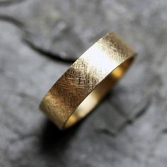 18k yellow gold wedding band rustic texture 6mm by metalicious