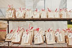 Love the bakers twine with the brown paper and clothespins. Click through and check out the whole wedding -- they pretty much nail the balance I'm looking for between vintage/rustic without being too formal or too casual...
