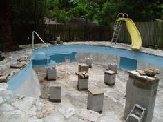 Turn old pool into a pound patio pond natural - Swimming pool to fish pond conversion ...