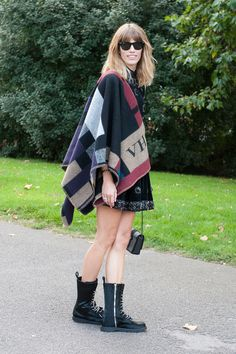 Burberry's monogrammed poncho made another appearance on the street.