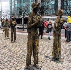 """""""Famine"""" by Rowan Gillespie - Custom House Quay, Dublin -memorial statues to the The Great Famine in Ireland that let to many Irish migrating to North America."""