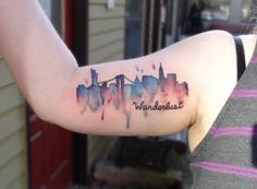 NYC Skyline tattoo in watercolor, done by Emily Kaul at Opal Ink...