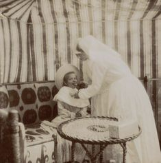 Anastasia with 2 nurses in 1907. At the time she was sick with diphtheria. Source: https://m.vk.com/naaotma