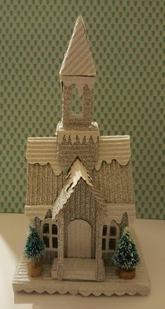 I love the tim holtz accessory dies for the houses. Made a church finally! Found this awesome corrugated and glittered paper at American . Christmas Tree Village Display, Christmas Village Houses, Putz Houses, Christmas Ornaments To Make, Miniature Christmas, Christmas Villages, Retro Christmas, Christmas Home, Christmas Crafts